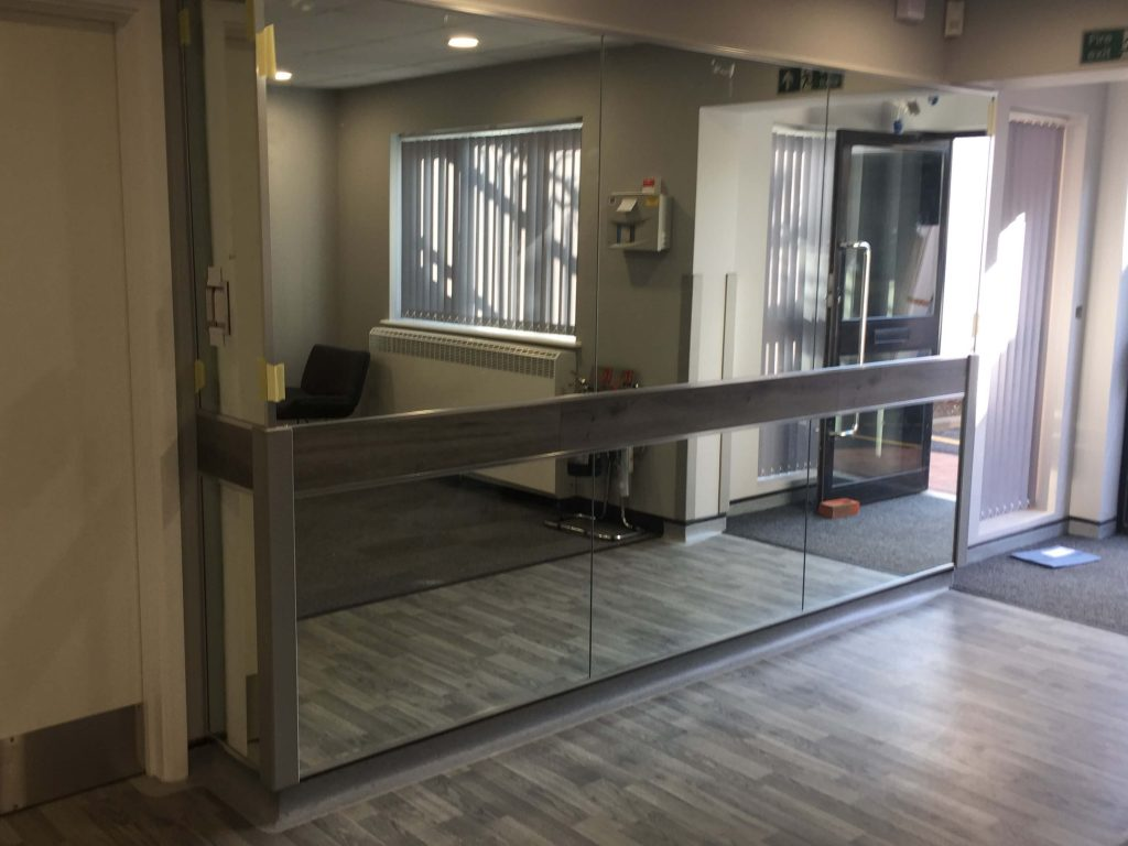 Wall Mirrors with Barrier Protection